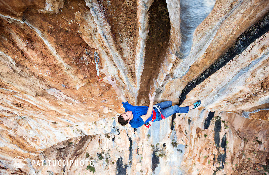 Climbing tufas on Morphi, 8b+, at Twin Caves, Leonidio, Greece. Leonidio is a relatively new climbing area with huge potential as a winter sport climbing destination.