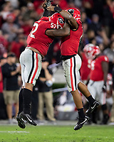 ATHENS, GA - NOVEMBER 23: Tyler Clark #52 and Nolan Smith #4 of the Georgia Bulldogs celebrate after Clark's sack during a game between Texas A