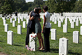 """Sept. 10, 2011.""""The President hugs a woman during a visit with the First Lady to Section 60 of Arlington National Cemetery in Arlington, Virginia. Section 60 is reserved for military personnel who have lost their lives while fighting in Afghanistan and Iraq."""".Mandatory Credit: Pete Souza - White House via CNP"""