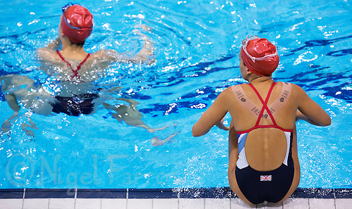 26 JUL 2012 - LONDON, GBR - Synchronised Swimmer Asha Randall (GBR) (right) of Great Britain waits for the start of practice at the Aquatics Centre in the Olympic Park, Stratford, London, Great Britain ahead of the start of the London 2012 Olympic Games .(PHOTO (C) 2012 NIGEL FARROW)