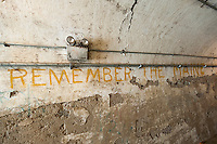 "Original graffiti urges visitors to ""Remember the Maine"" in the transport tunnel in historic Fort Totten Water Battery in Fort Totten in the Bayside neighborhood of Queens in New York on Sunday, June 15, 2014. The explosion of the Battleship Maine precipitated the Spanish-American War. Construction on the historic fort started in 1862 on Willet's Point overlooking the East River into Long Island Sound.   (© Richard B. Levine)"