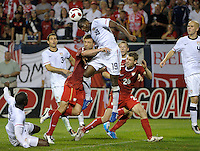 US defender Maurice Edu (19) heads the ball while being run into by Poland defender Dariusz Pietrasiak (24).  The U.S. Men's National Team tied Poland 2-2 at Soldier Field in Chicago, IL on October 9, 2010.