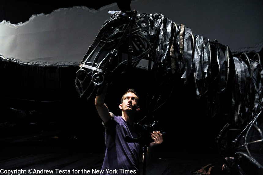 UK. London. 8th July 2009.Puppeteer Toby Olie controls the head of a horse during a rehearsal of War Horse..©Andrew Testa for the New York Times