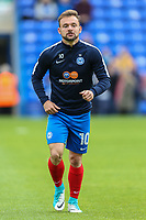 Danny Lloyd of Peterborough United warms up ahead of the Sky Bet League 1 match between Peterborough and Oxford United at the ABAX Stadium, London Road, Peterborough, England on 30 September 2017. Photo by David Horn.
