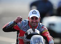 Nov. 13, 2011; Pomona, CA, USA; NHRA pro stock motorcycle rider Eddie Krawiec celebrates after winning the 2011 championship during the Auto Club Finals at Auto Club Raceway at Pomona. Mandatory Credit: Mark J. Rebilas-.