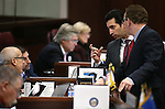 Nevada Sens., from left, Mo Denis, Mark Manendo, Ruben Kihuen and Ben Kieckhefer work on the Senate floor at the Legislative Building in Carson City, Nev., on Friday, Dec. 18, 2015. Lawmakers are working in a special Legislative session to consider an economic development deal between the state and Faraday Future. <br /> Photo by Cathleen Allison