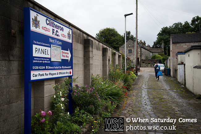 Clitheroe 0 Consett 1, 20/08/2016. Shawbridge, Northern Premier League Division One North. A home player arriving at the ground before Clitheroe played Consett at Shawbridge in an FA Cup preliminary round tie. Northern Premier League division one north team Clitheroe were formed in 1877 and have played at the same ground since. Visitors Consett, from the Northern League division one, won the match 1-0, watched by 207 spectators. Photo by Colin McPherson.