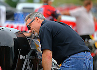Jun 19, 2015; Bristol, TN, USA; NHRA pro stock team owner Victor Cagnazzi (right) talks to top fuel driver Dave Connolly during qualifying for the Thunder Valley Nationals at Bristol Dragway. Mandatory Credit: Mark J. Rebilas-