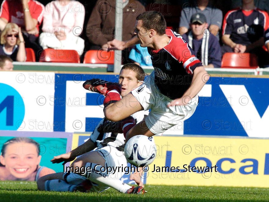 14/10/2006       Copyright Pic: James Stewart.File Name :jspa01_falkirk_v_st_mirren.STEVEN THOMSON IS CAUGHT LATE BY HUGH MURRAY.Payments to :.James Stewart Photo Agency 19 Carronlea Drive, Falkirk. FK2 8DN      Vat Reg No. 607 6932 25.Office     : +44 (0)1324 570906     .Mobile   : +44 (0)7721 416997.Fax         : +44 (0)1324 570906.E-mail  :  jim@jspa.co.uk.If you require further information then contact Jim Stewart on any of the numbers above.........