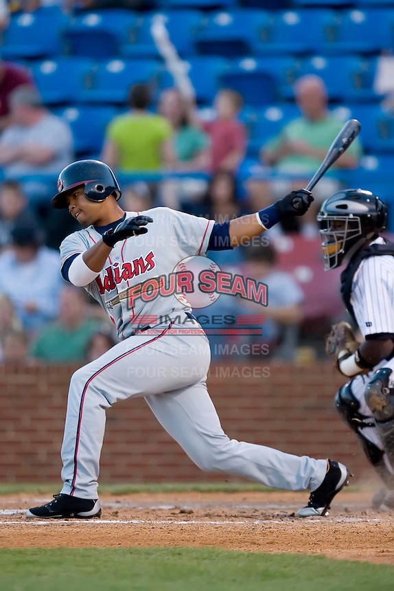 Alex Castillo (7) of the Kinston Indians follows through on his swing versus the Winston-Salem Warthogs at Ernie Shore Field in Winston-Salem, NC, Saturday May 17, 2008.