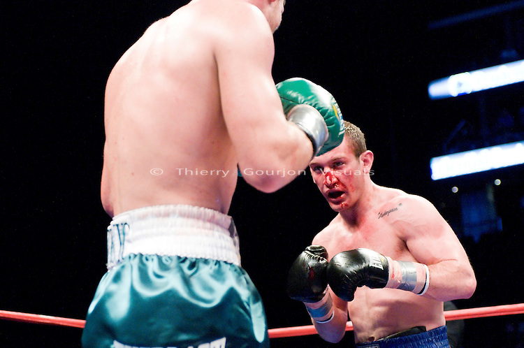 Newark, NJ - 05.24.2009: Billy Lyell (blue trunks) on the attack against John Duddy (green truns) during their 10 rounds middleweight fight at the Prudential arena. Lyell pulled off the upset victory by beating the previously unbeaten Duddy via a split decision. Photo by Thierry Gourjon.
