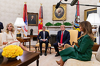 United States President Donald J. Trump and First Lady Melania Trump meet with the Prime Minister of the Czech Republic Andrej Babis and his wife Monika Babisova in the Oval Office at the White House in Washington, D.C. on March 7, 2019. <br />   <br /> CAP/MPI/CNP/AE<br /> &copy;AE/CNP/MPI/Capital Pictures