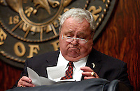 TALLAHASSEE, FL. 4/28/03-Senate President Jim King looks over some documents at the close of session Monday night at the Capitol in Tallahassee. The House and Senate have moved close enough to each others budget numbers that they are planning to extend the legislative session to complete their business. COLIN HACKLEY PHOTO