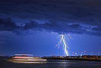 Boston, MA  -  Lightning strikes over Boston Harbor as a boat takes a cruise. Tuesday, July 24, 2012.