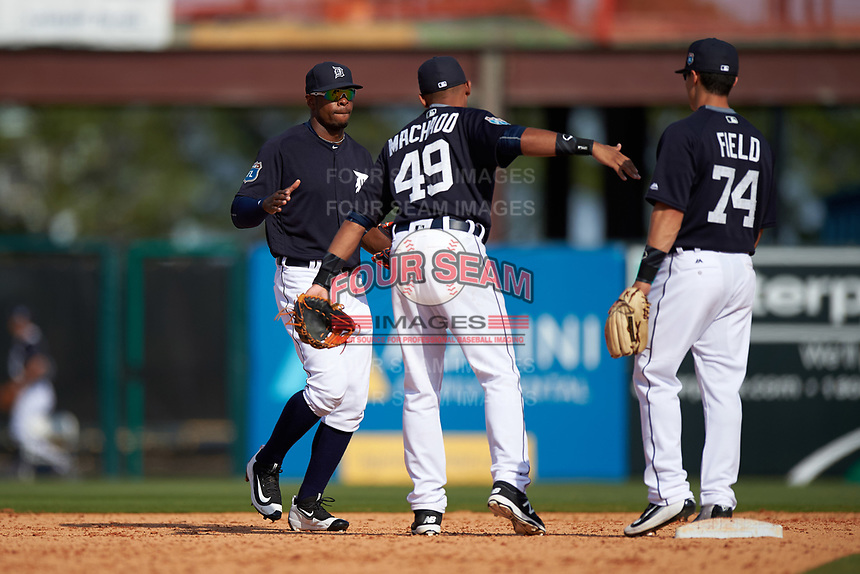 Detroit Tigers center fielder Wynton Bernard (63) celebrates with Dixon Machado (49) and Tommy Field (74) after winning an exhibition game against the Florida Southern Moccasins on February 29, 2016 at Joker Marchant Stadium in Lakeland, Florida.  Detroit defeated Florida Southern 7-2.  (Mike Janes/Four Seam Images)