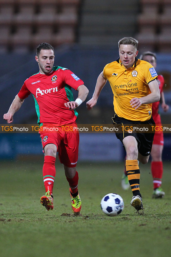 Robbie Willmott of Newport County and Tom Shaw of Cambridge United - Cambridge United vs Newport County - Blue Square Conference Premier Football at the R Costings Abbey Stadium - 05/04/13 - MANDATORY CREDIT: Gavin Ellis/TGSPHOTO - Self billing applies where appropriate - 0845 094 6026 - contact@tgsphoto.co.uk - NO UNPAID USE.