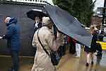 © Joel Goodman - 07973 332324 . 28/03/2015 . Manchester , UK . A man with an upturned umbrella walks passed a queue of Conservative Party delegates in the rain ahead of the Conservative Party Spring Forum at the Old Granada Studios , Quay Street , Manchester . Photo credit : Joel Goodman