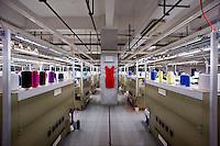 Hangzhou, Cina. Il reparto cuciture di una fabbrica di seta in Hangzou<br /> A red dress in the seving section in a silk factory in Hangzhou