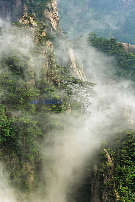 Mist among the peaks and valleys of Grand Canyon in West Sea, Mt. Huang Shan or Yellow Mountain, China