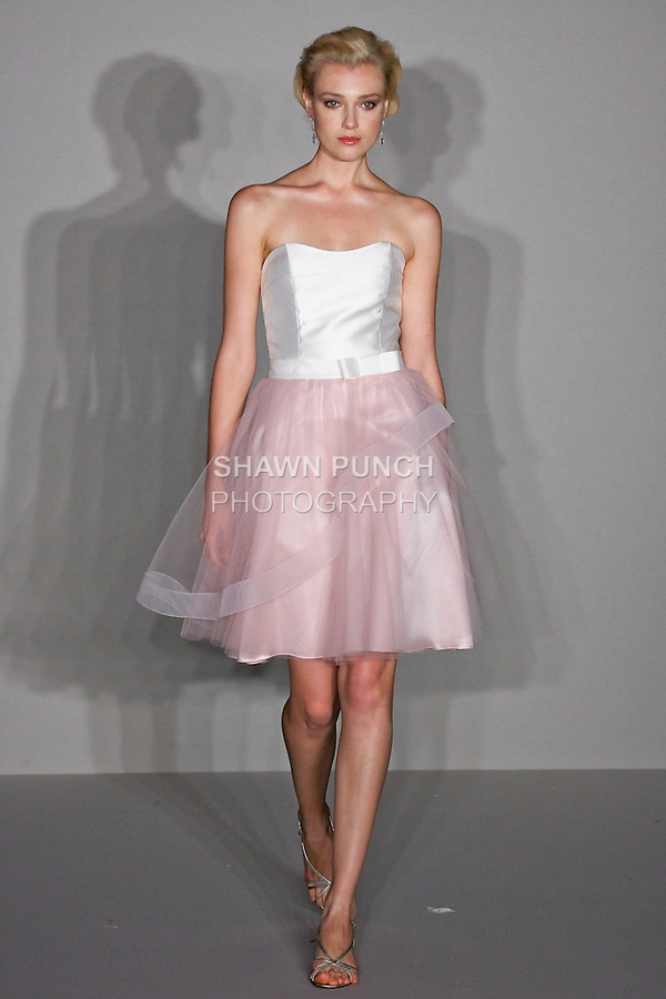 Model walks runway in an Ivory mikado strapless soft scoop neckline bodice, and Skirt- Rosewater short tulle skirt with horsehair detail, grosgrain ribbon and tailored bow at waist bridesmaid outfit by Jessica Williams, for the Alvina Valenta Spring 2012 Bridal collection, at the JLM Couture fashion show, during Bridal Week New York Spring 2012.