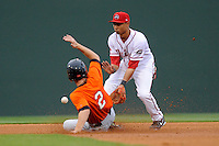 Second baseman Mookie Betts (7) of the Greenville Drive tries to catch the throw from home as Matt Duffy of the Augusta GreenJackets slides in safely in a game on Friday, May 10, 2013, at Fluor Field at the West End in Greenville, South Carolina. (Tom Priddy/Four Seam Images)