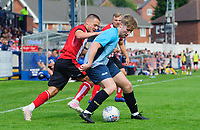 Gainsborough Trinity's trialist shields the ball from Lincoln City's Jack Payne<br /> <br /> Photographer Chris Vaughan/CameraSport<br /> <br /> Football Pre-Season Friendly (Community Festival of Lincolnshire) - Gainsborough Trinity v Lincoln City - Saturday 6th July 2019 - The Martin & Co Arena - Gainsborough<br /> <br /> World Copyright © 2018 CameraSport. All rights reserved. 43 Linden Ave. Countesthorpe. Leicester. England. LE8 5PG - Tel: +44 (0) 116 277 4147 - admin@camerasport.com - www.camerasport.com