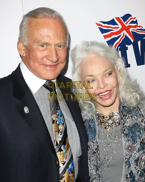 BUZZ ALDRIN & LOIS DRIGGS CANNON.The BritWeek 2010 Champagne Launch held At The British General Consul Residence, Los Angeles, California, USA..April 20th, 2010.half length black suit jacket grey gray married husband wife blue embellished jewel encrusted .CAP/ADM/KB.©Kevan Brooks/AdMedia/Capital Pictures.