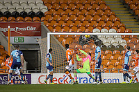 Kelvin Mellor (left) of Blackpool scores the first goal during the The Checkatrade Trophy match between Blackpool and Wycombe Wanderers at Bloomfield Road, Blackpool, England on 10 January 2017. Photo by Andy Rowland / PRiME Media Images.