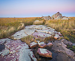 Blue Mounds State Park, MN<br /> Evening light on exposed quartzite rocks among the prairie grasses, Dane County