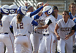 The Western Nevada College Wildcats greet Meghan Hospodka at the plate after she hit a three-run homer against Snow College at Edmonds Sports Complex in Carson City, Nev., on Friday, March 6, 2014. The Wildcats won the first game 3-1.<br />