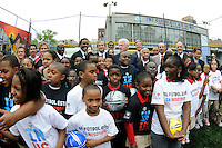Former President Bill Clinton (C) poses for photos with U.S. Soccer President and USA Bid Committee Chairman Sunil Gulati and other members of the Bid Committee during press conference announcing former President Bill Clinton as the honorary chairman of the USA Bid Committee to host the FIFIA World Cup in 2018 or 2022 at the FC Harlem Field in Harlem, NY, on May 17, 2010.