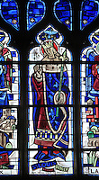 Saint Louis, King Louis IX of France, born in Poissy in 1214, stained glass window in the Chapelle St Barthelemy in the Collegiale Notre-Dame de Poissy, a catholic parish church founded c. 1016 by Robert the Pious and rebuilt 1130-60 in late Romanesque and early Gothic styles, in Poissy, Yvelines, France. The Collegiate Church of Our Lady of Poissy was listed as a Historic Monument in 1840. Picture by Manuel Cohen
