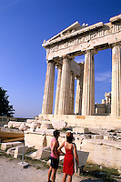Tourists looking up at the Acropolis and parthenon in Athens Greece one of the best known ruins in the world