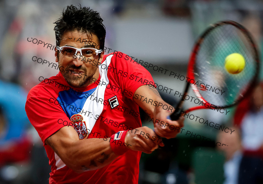 BELGRADE, SERBIA - JULY 15: Janko Tipsarevic of Serbia returns the ball to Kyle Edmund of Great Britain during the Davis Cup Quarter Final match between Serbia and Great Britain on Stadium Tas Majdan on July 15, 2016 in Belgrade, Serbia. (Photo by Srdjan Stevanovic/Getty Images)