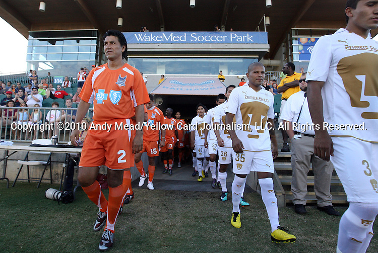 05 September 2010: Carolina's Claudio Suarez (MEX) (2) and Pumas Morelos's Fernando Santana (35) march onto the field with the other starters. The Carolina RailHawks (USA) defeated Pumas Morelos (MEX) 3-0 at WakeMed Stadium in Cary, North Carolikna in an international club friendly.