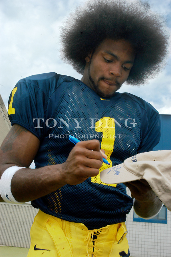 Michigan junior wide-receiver Braylon Edwards signs a hat for fans during the annual Michigan Football Media Day at Schembechler Hall on Saturday, August 9, 2003 (TONY DING/Daily).