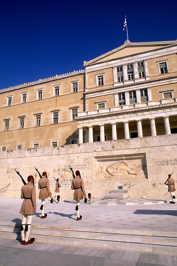 Greece Athens Parliament and soldier guards high stepping at the Tomb of the Unknown Soldier