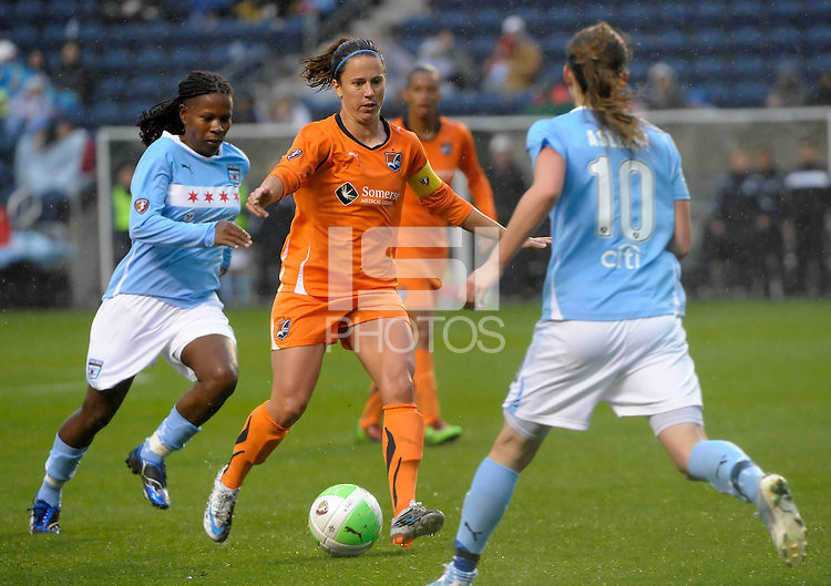 Sky Blue midfielder Kacey White (14) looks for room to maneuver in between Chicago midfielder Formiga (8) and forward Kosovare Asllani (10).  Sky Blue FC defeated the Chicago Red Stars 1-0 at Toyota Park in Bridgeview, IL on April 25, 2010.