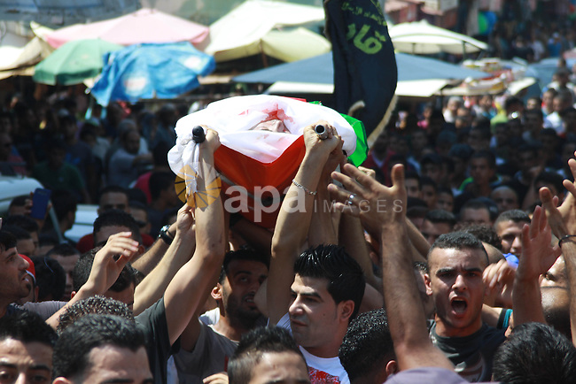 Palestinians carry the body of Kareem Abo Sbeih during his funeral in the Jenin refugee camp, near the West Bank city of Jenin August 31, 2013. Abo Sbeih died from his wounds on Saturday after Israeli soldiers shot dead a man and wounded two others during a raid in the Jenin refugee camp in the occupied West Bank early on August 20, Palestinian medical officials said. An Israeli military spokeswoman said security forces arrested a suspected militant in Jenin and, after being attacked, shot back. She said one Palestinian was apparently killed and two soldiers slightly hurt.. Photo by Nedal Eshtayah