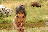 A young Peruvian girl bathes in a river in the countryside near Cusco. Children in Peru may or may not attend school. Children living in smaller, remote villages may not have access to schooling. Besides the high cost of enrolling children in school, the nearest school may be so far from a child's village that they have difficulty attending.