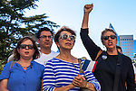 The Alliance Francaise de Sacramento held a vigil for the Nice massacre victims at the California State Capitol on Monday, July 18, 2016.  The Sacramento French Honorary Consul Guy Michelier spoke to the crowd, asked for a moment of silence, followed by singing La Marseillaise the national anthem of France. Michelle Collins, of Sacramento, raises her fist during the singing of La Marseillaise, she is joined by her friend Christine Rodriguez, center, of Sacramento, and Kristin Rapinac, left, the President of the Board of Directors of Alliance Francaise de Sacramento. The vigil was held for the victims of the Bastille Day, July 14, 2016, attack in France.  Photo/Victoria Sheridan