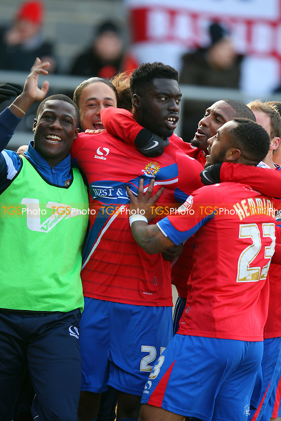Ayo Obileye of Dagenham and Redbridgeis congratulated after scoring the opening Daggers goal - Dagenham and Redbridge vs Southend United - SkyBet League Two football at the London Borough of Barking and Dagenham Stadium on  14/03/15 - MANDATORY CREDIT: Dave Simpson/TGSPHOTO - Self billing applies where appropriate - 0845 094 6026 - contact@tgsphoto.co.uk - NO UNPAID USE