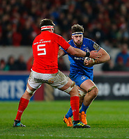 28th December 2019; Thomond Park, Limerick, Munster, Ireland; Guinness Pro 14 Rugby, Munster versus Leinster; Caelan Doris of Leinster tries to get past Billy Holland (C) of Munster - Editorial Use