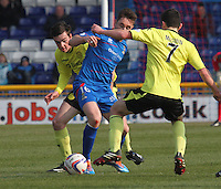 Greg Tansey sandwiched between Sean Kelly (left) and John McGinn in the Inverness Caledonian Thistle v St Mirren Scottish Professional Football League Premiership match played at the Tulloch Caledonian Stadium, Inverness on 29.3.14.