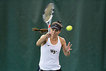 Mary Caroline Meredith of the Wake Forest Demon Deacons returns the ball during the match against the Liberty Flames at the Wake Forest Indoor Tennis Center on March 11, 2017 in Winston-Salem, North Carolina. The Demon Deacons defeated the Flames 6-1.  (Brian Westerholt/Sports On Film)