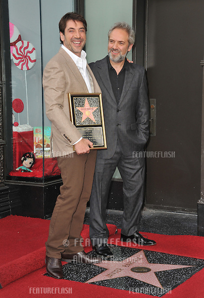 Javier Bardem & director Sam Mendes (right) on Hollywood Boulevard where he was honored with the 2,484th star on the Hollywood Walk of Fame..November 8, 2012  Los Angeles, CA.Picture: Paul Smith / Featureflash