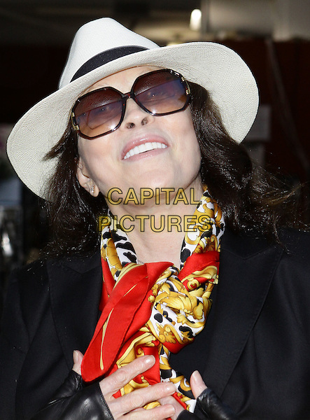 FAYE DUNAWAY.Rocket Video's Grand Re-Opening Celebration held at Rocket Video Store, Los Angeles, California, USA, .10th July 2010..portrait headshot  hat sunglasses red black jacket print scarf boater smiling .CAP/ADM/TC.©T. Conrad/AdMedia/Capital Pictures.