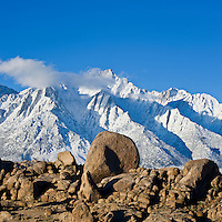 rock formations of Alabama Hills with Lone Pine peak and Sierra Nevada mountains in background, California