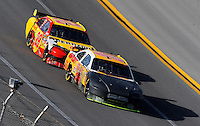 Apr 26, 2009; Talladega, AL, USA; NASCAR Sprint Cup Series driver Jeff Gordon (24) leads Kevin Harvick as they race after being involved in a crash earlier during the Aarons 499 at Talladega Superspeedway. Mandatory Credit: Mark J. Rebilas-
