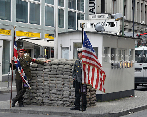 "Berlin, Germany - August 11, 2009 -- ""Checkpoint Charlie"" the legendary Cold War barrier between east and west looking towards the west in Berlin, Germany on Tuesday, August 11, 2009.  The two ""soldiers"" pose for photos with tourists for a fee..Credit: Ron Sachs / CNP"